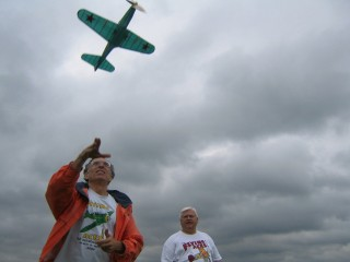 Men Flying a Model Plane